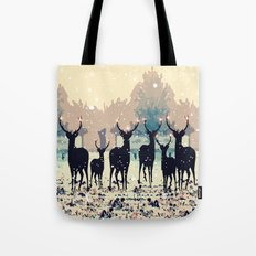 Deer in the snowy forest Tote Bag