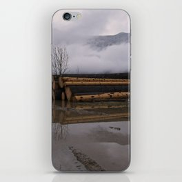 Timber Logs With A Foggy Mountain View iPhone Skin