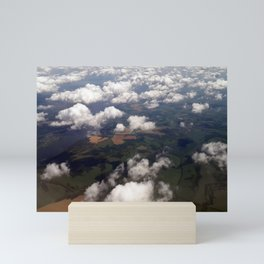 Panorama of clouds and earth from an airplane Mini Art Print