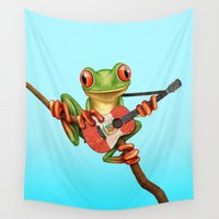 peru Wall Tapestries featuring Tree Frog Playing Acoustic Guitar with Flag of Peru by Jeff Bartels
