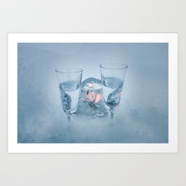 Two vodka shots and cyrstal tealight holder with burning tealight in snow close front view Art Print