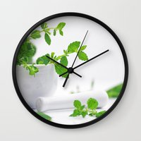 melissa smith Wall Clocks featuring Melissa officinalis by Tanja Riedel