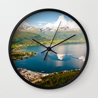norway Wall Clocks featuring Sandane, Norway by MankiniPhotography