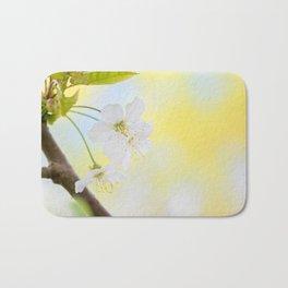 Macro shot of blooming apple tree over yellow background Bath Mat