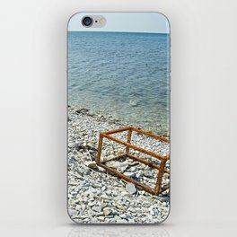 Sea and rusty frame box on shore iPhone Skin