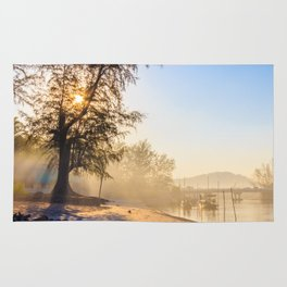 Misty morning on a river estuary, Trang province, Thailand Rug