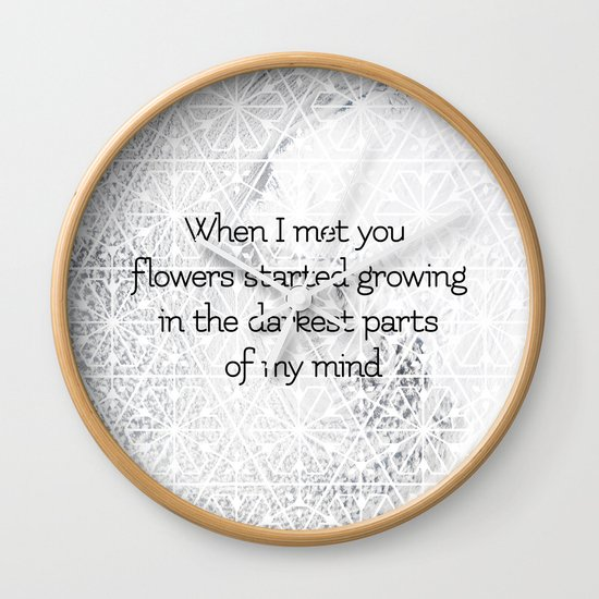 Flowers started growing Wall Clock