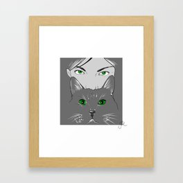 The girl and the cat. Framed Art Print