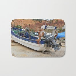 Fishing boat on the beach Bath Mat