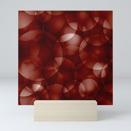 Dark intersecting burgundy translucent circles in bright colors with a brick glow. Mini Art Print