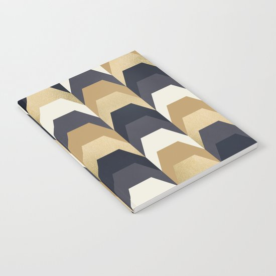 Stacks of Gold and Navy Notebook