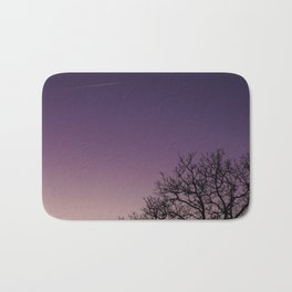 A bare tree in the sunset. Bath Mat