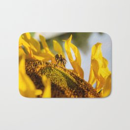 Bumble bee in the sunflower Bath Mat