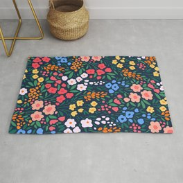 Vintage floral background. Flowers pattern with small colorful flowers on a dark blue background.  Rug