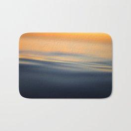 Calm sea at sunset time Bath Mat