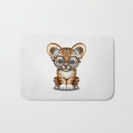 Cute Baby Tiger Cub Wearing Eye Glasses on White Bath Mat