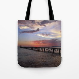 Anglers in the sunrise at the sea Tote Bag