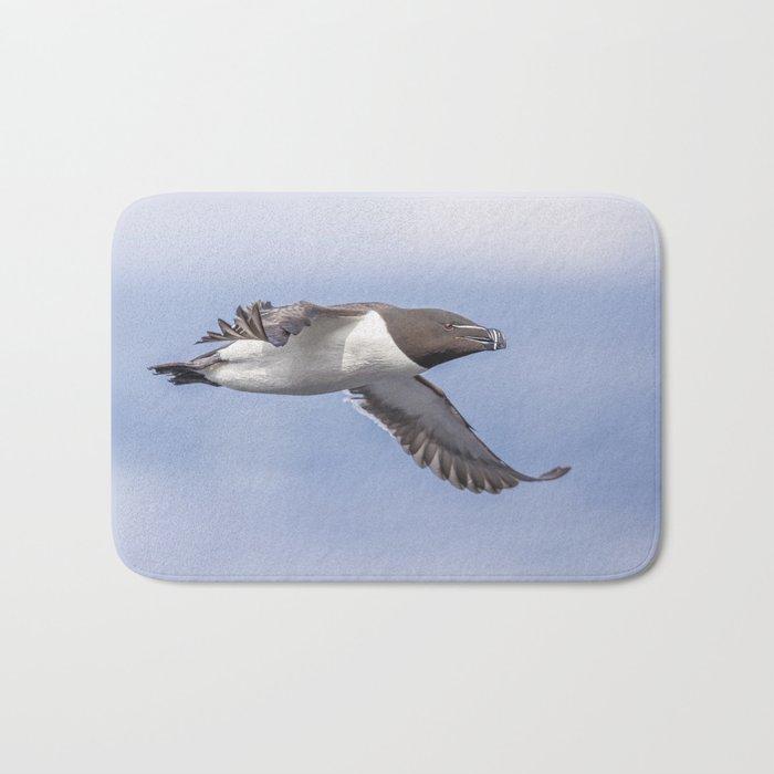 Razorbill in flight Bath Mat