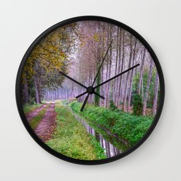 Country road close to an irrigation ditch in a natural park during autumn Wall Clock