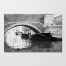 the boats sit quietly in the Venice Canals; black and white photography Canvas Print