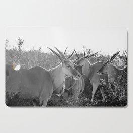 Herd of Eland stand in tall grass in African savanna Cutting Board