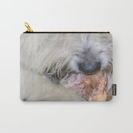 Cute sweet furry dog eating a bone, lying on a wooden parquet floor Carry-All Pouch