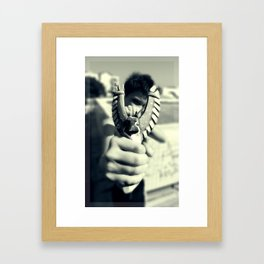 Boy with a slingshot Framed Art Print
