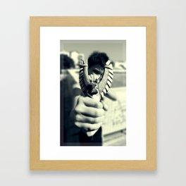 Boy with a slingshot Framed Art Print