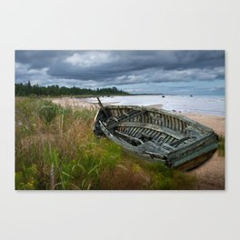 Shipwrecked Wooden Boat on Lakeshore with Sandy Beach and Dune Grass Canvas Print