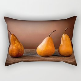Three large yellow bosc pears on a barn wood table Rectangular Pillow