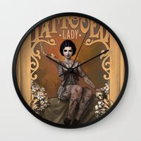lady gaga Wall Clocks featuring The Amazing Tattooed Lady by Rudy Faber