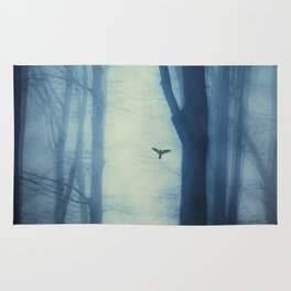 waning lines - trees in fog Rug