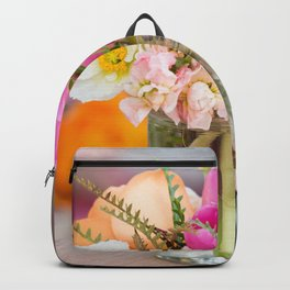 Pretty flowers displayed in a glass mason jar. Backpack