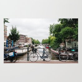 Bicycles in Amsterdam canal Rug