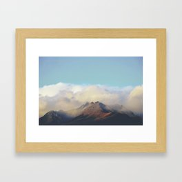 Sun kissed summit in the clouds Framed Art Print