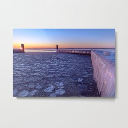 Landscape photography: a frozen jetty with icicles and frozen water during a clear colorful sunrise Metal Print