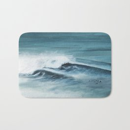 Surfing big waves Bath Mat
