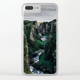 Fast flowing river making (wending) it's way between two massive rock formations Clear iPhone Case