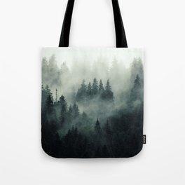 Misty pine fir forest landscape in hipster vintage retro style Tote Bag