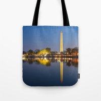 washington dc Tote Bags featuring Washington DC Dawn Monument by Nicolas Raymond