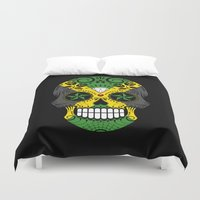 jamaica Duvet Covers featuring Sugar Skull with Roses and Flag of Jamaica by Jeff Bartels