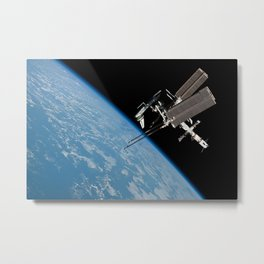 The International Space Station and the Docked Space Shuttle Endeavour Metal Print