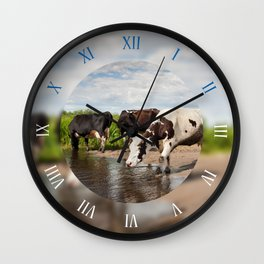 Herd of cows walking in puddle Wall Clock