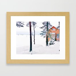 Icy lake view with red brick house Framed Art Print