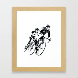 Bicycle racers into the curve... Framed Art Print