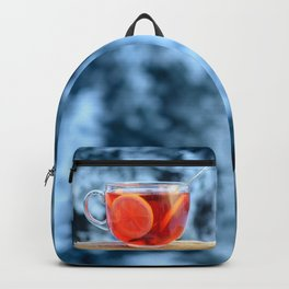 Hot fruit tea with lemon rings on a winter day. Backpack