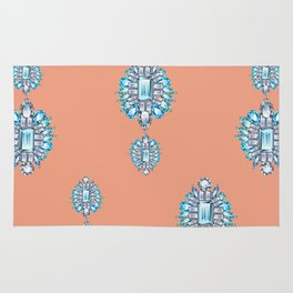Jewelbox: Aquamarine Brooch on Coral Spice Rug