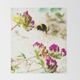 the flight of bumble bee on the dunes I Throw Blanket