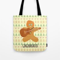 ed sheeran Tote Bags featuring Gingerbread Ed by Laura Maria Designs