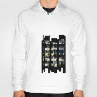 building Hoodies featuring Building by Mirko Dessureault